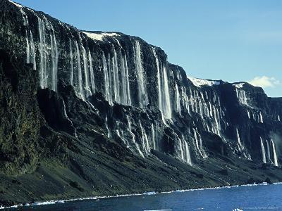 Waterfalls Cascading Down Cliffs, Vega Isle, East Side Antarctic Peninsula