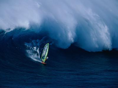 A Windsurfer Riding a Big Wave