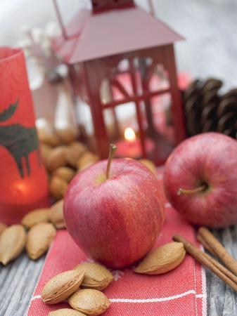 Christmas Decoration with Apples, Nuts, Cinnamon & Lantern