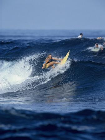 Female Surfer Riding a Wave
