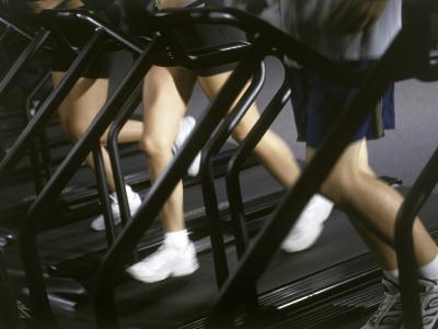 Low Section View of People Running on Treadmills in a Gym