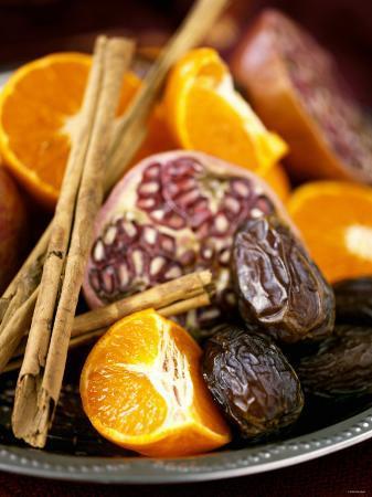 Mandarin Oranges, Dates, Pomegranate and Cinnamon Sticks