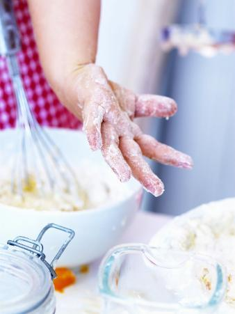 Child's Hand Covered in Dough