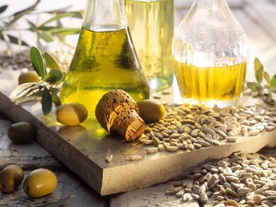 Various Oils in Carafes, Olives, Sunflower Seeds