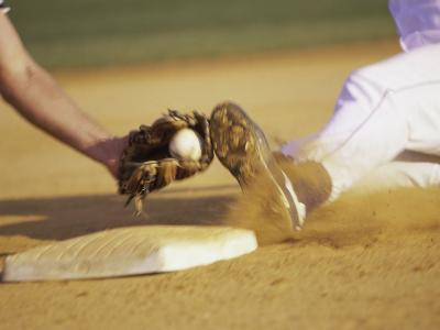 Baseball Player Sliding at a Base, and a Gloved Hand Holding a Ball