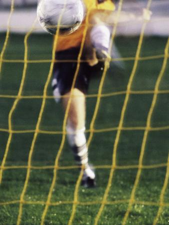 Soccer Player Kicking a Soccer Ball