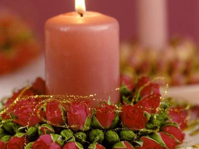 Pink Candle with Wreath of Rose Petals as Table Decoration
