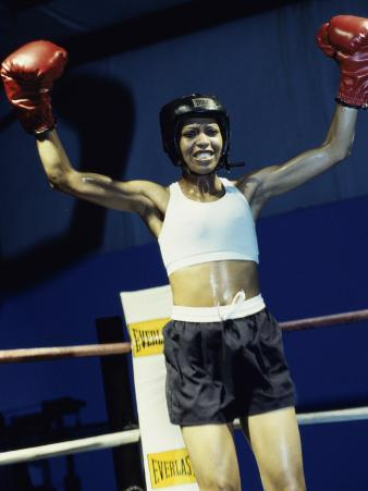 Young Woman Standing in a Boxing Ring