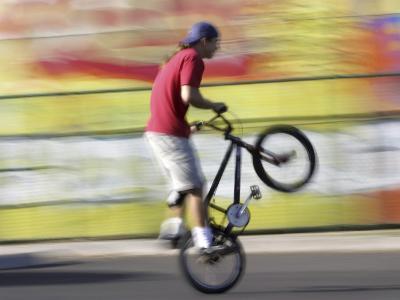 Bicyclist Riding on Rear Wheel