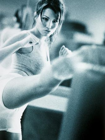Young Woman Exercising in a Gym