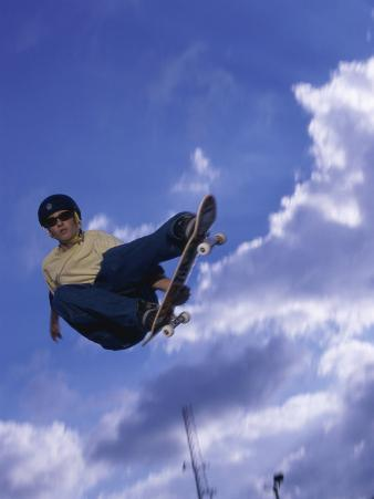 Low Angle View of a Young Man Skateboarding