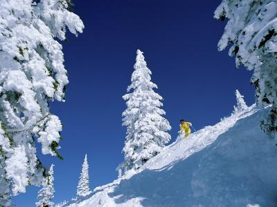 Pristine Snowscape with Skier in Yellow