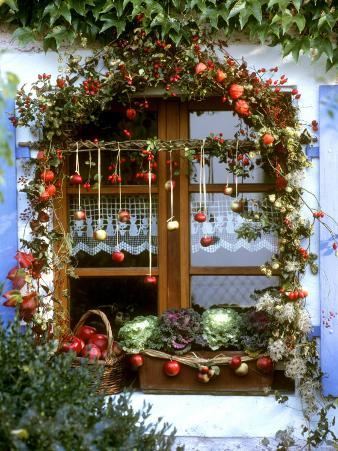 Autumnal Window Decoration with Apples and Cabbage