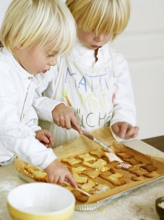 Two Children Brushing Biscuits with Glace Icing