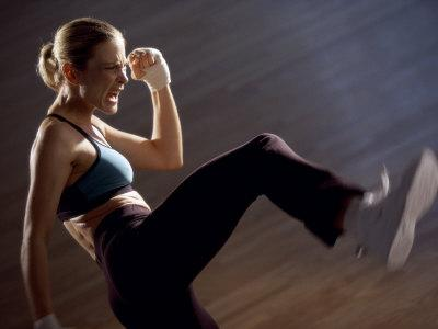 Side Profile of a Young Woman Kickboxing