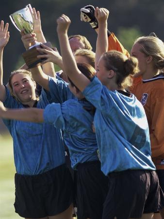 Teenage Girls on a Soccer Team Celebrating