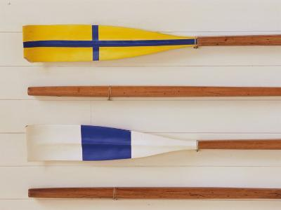An Array of boat oars Mounted on a wall