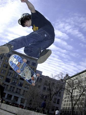 Skateboarder in Midair Doing a Trick