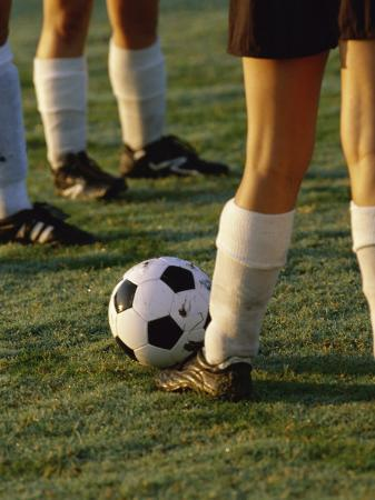Low Section View of Soccer Players Feet and a Soccer Ball
