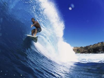 Wave Curling Up Over Surfer