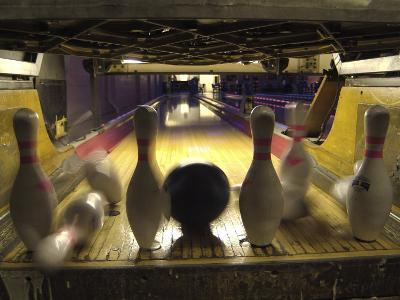 Rear View of Pins Being Struck by a Bowling Ball