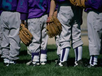 Rear View of a Little League Baseball Team Standing in a Row