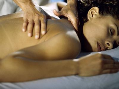 Close-up of a Young Woman Getting a Shoulder Massage