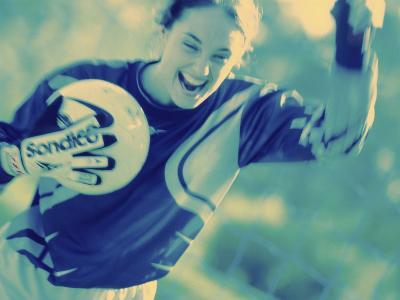Female Goalie Holding a Soccer Ball