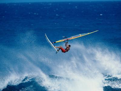 Man Windsurfing in the Sea