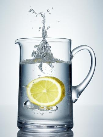 Lemon Falling into Jug of Water