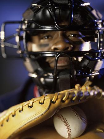 Portrait of a Baseball Catcher Holding a Baseball