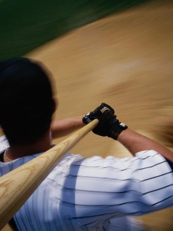 High Angle View of a Baseball Player Swinging a Baseball Bat