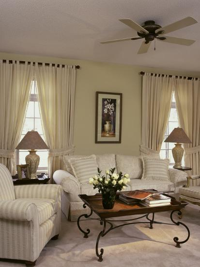 cream colored living room with ornate coffee table photographic print at. Black Bedroom Furniture Sets. Home Design Ideas