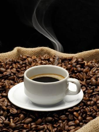 A Cup of Coffee on a Jute Sack Full of Coffee Beans