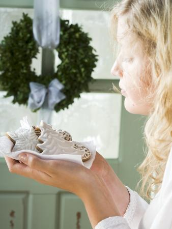 Blond Girl Holding Assorted Gingerbread Biscuits on Napkin