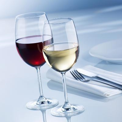 Glass of White Wine and Glass of Red Wine Beside Place-Setting
