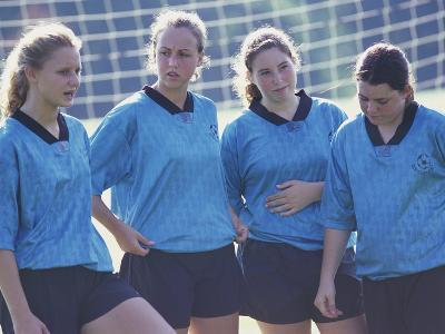 Teenage Girls on a Soccer Team Standing Together