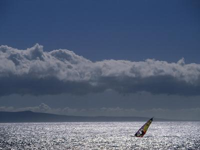 Picturesque Scene with Silhouetted Wind Surfer