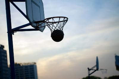 Hoops Basketball Game on the Streets Ring with a Net