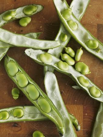 Broad Beans and Pods on a Wooden Surface
