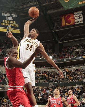 Chicago Bulls v Indiana Pacers - Game Three, Indianapolis, IN - APRIL 21: Paul George and Luol Deng