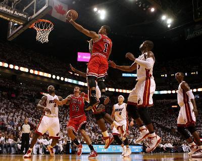 Chicago Bulls v Miami Heat - Game Three, Miami, FL - MAY 22: Derrick Rose and Dwyane Wade