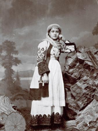 Full-Length Portrait of a Young Greek Woman in Traditional Attire. She is Wearing a Veil