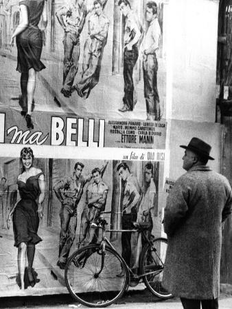 Man Looking at the Poster of the Film by the Film-Director Dino Risi, Poveri Ma Belli