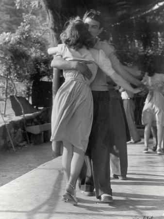 Man and a Woman Dancing in a Close Embrace