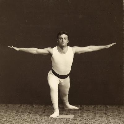 Portrait of a Young Gymnast as He Performs an Exercise