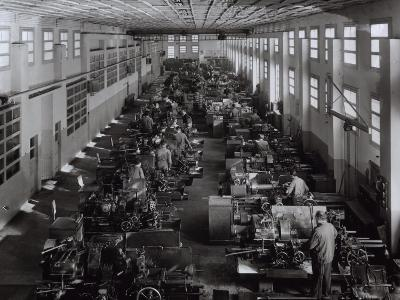 Many Workers Operating Machinery at the Ferrari Factory