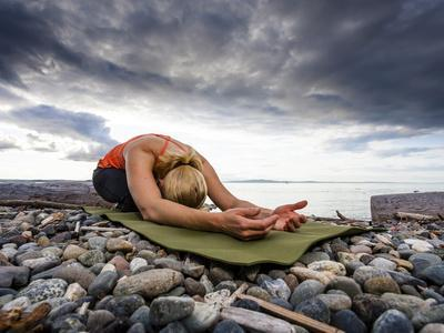 Yoga Position of Child's Pose in Lincoln Park - West Seattle, Washington