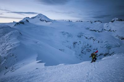 A Male Snowboarder in the Backcountry of North Cascades National Park, Washington