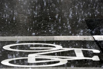 Rain Pours onto a Bicycle Lane